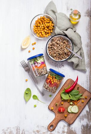 Healthy quinoa mason jar salad with chickpeas and vegetables, detox, diet and clean food concept on white background, top view Banco de Imagens