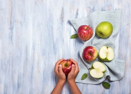 Childs hands holding apple, fresh apples, healthy eating and health care concept, copy space background