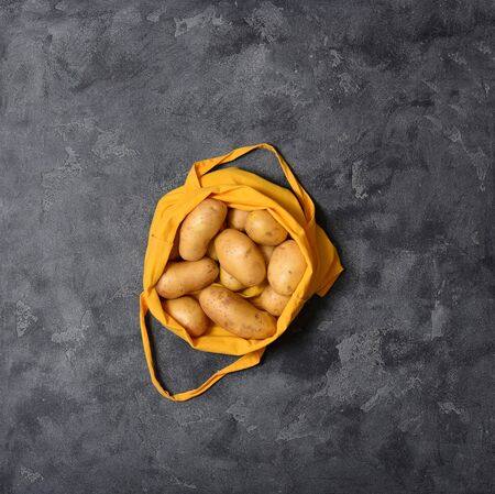 Cotton bag with potatoes, top view,  eco-friendly shopping, zero waste concept and lifestyle, blank space for text