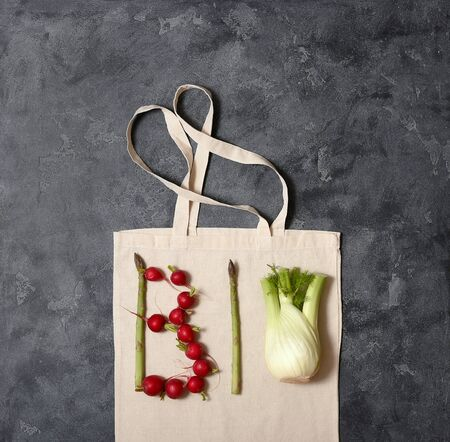 Word bio made of vegetables, bio and organic food concept, reusable cotton bag, space for text, eco-friendly shopping, zero waste concept and lifestyle