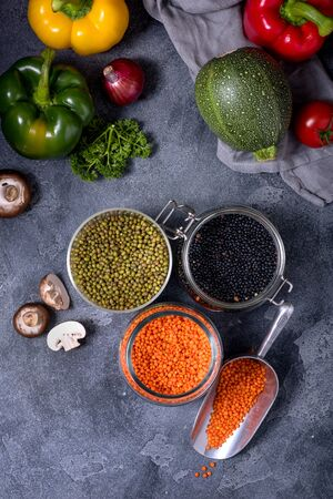 Legumes, raw lentlis and mung beans with vegetables for healthy vegan cooking, clean eating and healthy food Reklamní fotografie