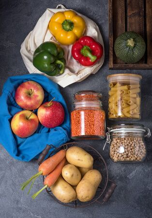 Eco-friendly lifestyle and shopping, zero waste, healthy organic vegetables and food in reusable cotton bag and glass jars