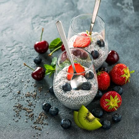 Chia seeds pudding with fruits and berries, healthy snack or breakfast, place for text background, diet, vegan eating concept Stockfoto