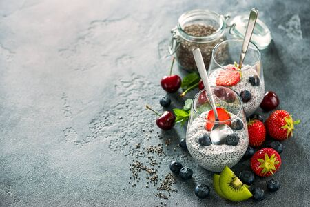 Chia seeds pudding with fruits and berries, healthy snack or breakfast, place for text background, diet, vegan eating concept Archivio Fotografico