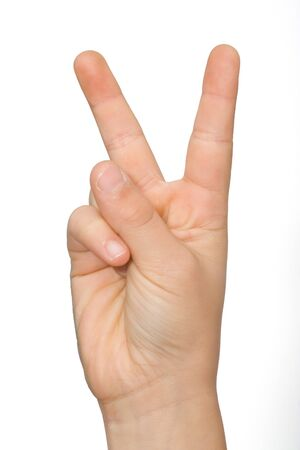A childs hand with the symbol of victory Stock Photo