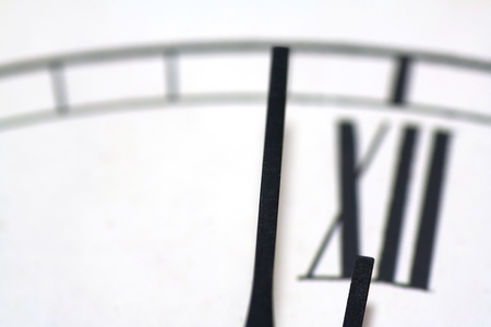 Close-up of a clock one minute before twelve Stock Photo - 10908736