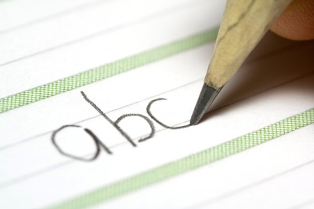 Close-up of a pencil writing the letters abc Stock Photo