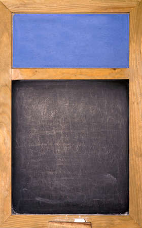 Emty blackboard with blue area and chalk photo