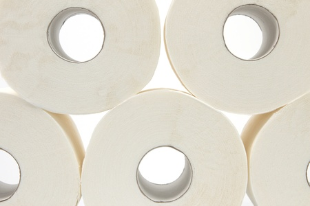 Five rolls of bathroom tissue with a white background photo