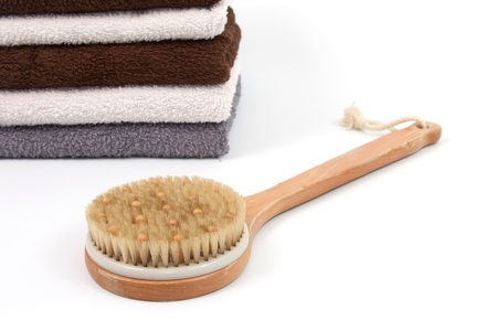 scrubber: Various towels and a scrubber with a white background