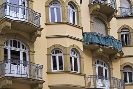Old baroque front with balconies and ornaments Standard-Bild