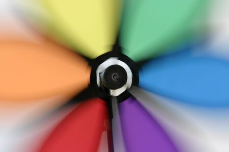 wind force wheel: Colourful wind wheel spinning in the wind Stock Photo