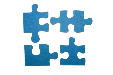 puzzles: Four blue pieces of a puzzle with a white background