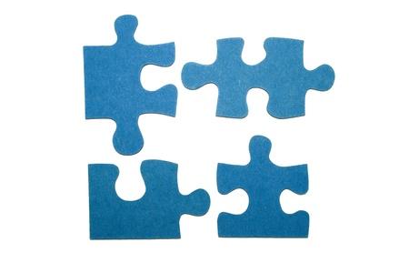 Vier blaue Teile eines Puzzles mit einem weißen Hintergrund Standard-Bild - 11214478
