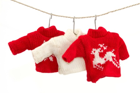 pullovers: Three pullovers and a clothesline with a white background