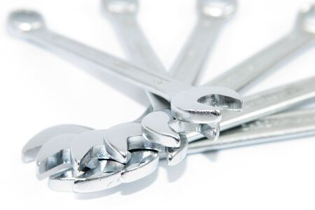 Different sized wrenches with a white background photo