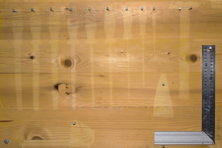 peg board: Empty pegboard with only a square in the corner