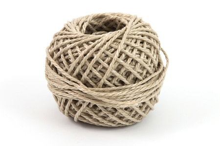 pack string: Ball of parcel string with a white background