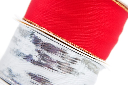 Closeup of red and silver gift ribbon with a white background photo