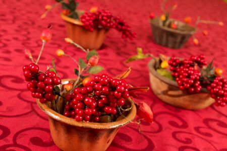 ornated: Four brown decorated bowls on a red ornated background