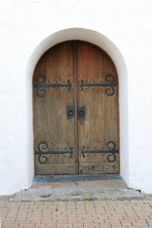 Old rounded entry door with a white front photo