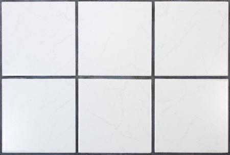 Sechs weiße Küchenfliesen mit dunklen Fugen Standard-Bild - 11323433