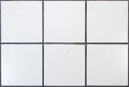 Six white kitchen tiles with dark joints Stock Photo