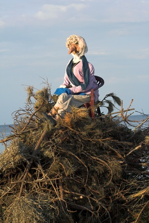 pyre: Burning of a witch at the beach Stock Photo