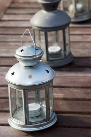 Three lanterns on a wooden table Stock Photo