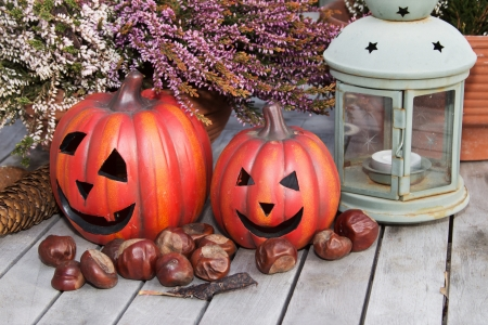 Halloween pumpkins with decoration on a wooden table Stock Photo