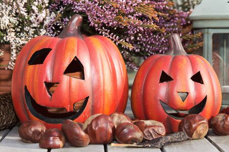 Halloween pumpkins with decoration on a wooden table photo