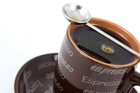 Brown espresso mug with a white background photo