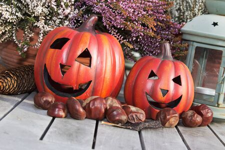 Halloween pumpkins with decoration on a wooden table Stock Photo - 11323572