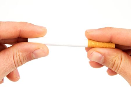 Two hands holding a cigarette in front of a white background