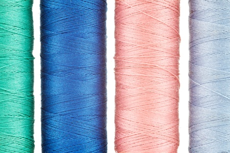 Closeup of sewing cotton in different colors photo