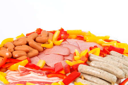 Different raclette ingredients in front of a white background Stock Photo - 11744793