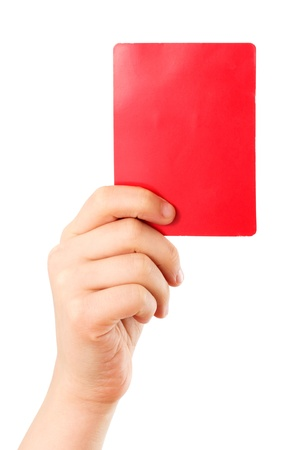 Red card in a hand in front of a white background