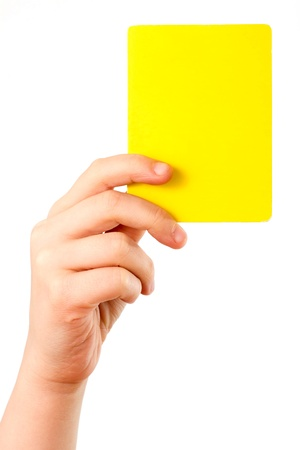Yellow card in a hand in front of a white background Stock Photo - 11856526