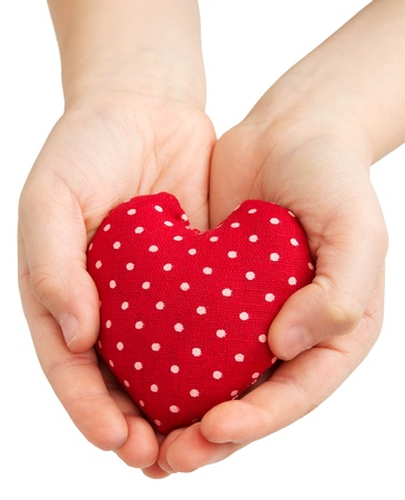 Two hands of a child holding a heart isolated on a white background photo