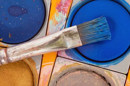 paintbox: Closeup of a brush on a paintbox