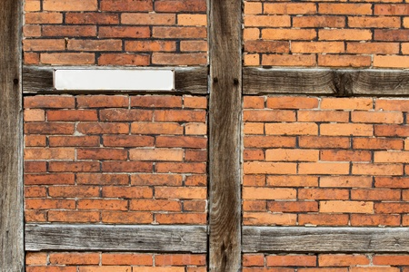 Old wooden framework front with a blank sign photo