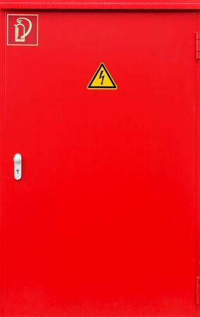 Red fire protection door with two signs photo