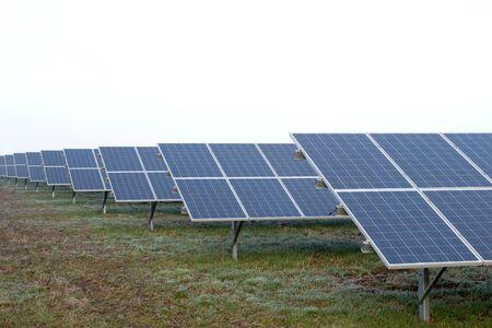 monocrystalline: Park with solar cells in front of a overcast sky Stock Photo