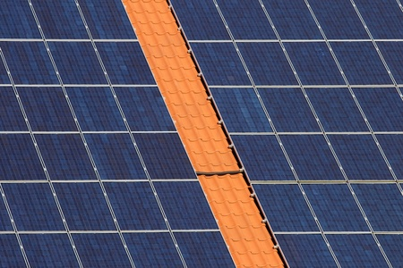 monocrystalline: Many panels with solar cells on a roof