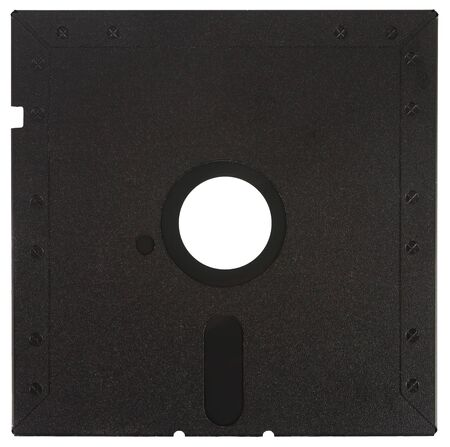 Back of a black floppy disk over a white background Stock Photo
