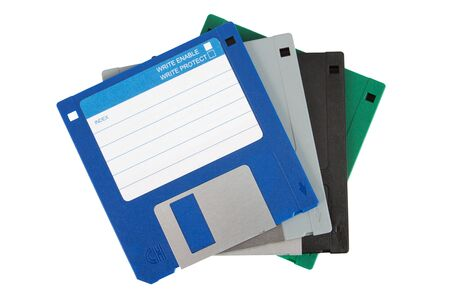 Four colored floppy disks over a white background