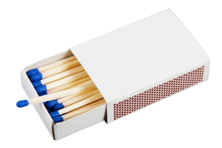 White box with matches over a white background