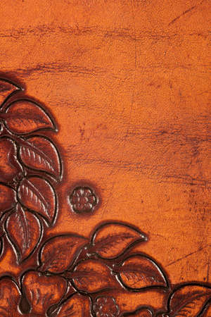Closeup of orange and brown ornate leather texture