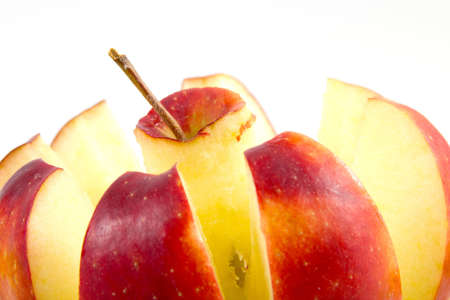 Closeup of a splitted apple over a white background Stock Photo - 12681135