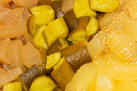 Closeup of different pickled cucumbers with mustard seeds Stock Photo - 12681223